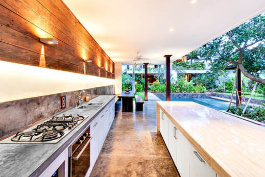 Outdoor Kitchen with Stove and Swimming Pool