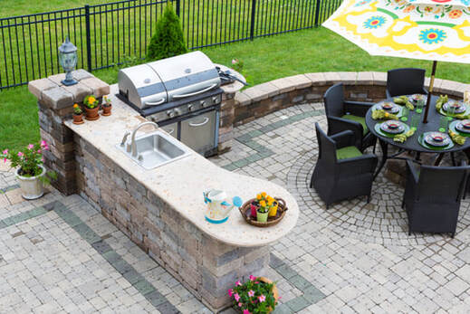 Stylish Outdoor Kitchen by Pool Builder Corpus Christi